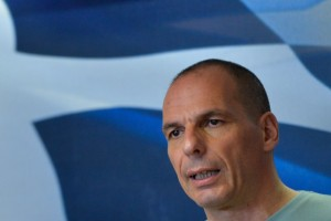 Greek Finance Minister Yanis Varoufakis delivers a press conference in Athens on July 5, 2015, after early results showed those who rejected further austerity measures in a Greek crucial bailout referendum were poised to win. Over 61 percent of Greek voters on July 5 rejected fresh austerity demands by the country's EU-IMF creditors in a historic referendum, official results from 50 percent of polling stations showed. AFP PHOTO / ANDREAS SOLARO