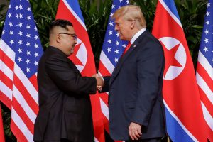 Mandatory Credit: Photo by Evan Vucci/AP/Shutterstock (9710094b) Donald Trump, Kim Jong Un. U.S. President Donald Trump shakes hands with North Korea leader Kim Jong Un at the Capella resort on Sentosa Island in Singapore Trump Kim Summit, Singapore, Singapore - 12 Jun 2018